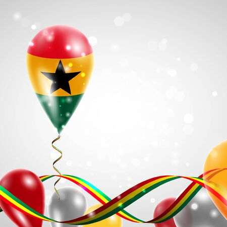 feast: Flag of Ghana on balloon. Celebration and gifts. Ribbon in the colors of the flag are twisted under the balloon. Independence Day. Balloons on the feast of the national day.