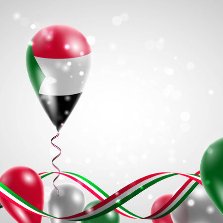 feast: Flag of Sudan on balloon. Celebration and gifts. Ribbon in the colors of the flag are twisted under the balloon. Independence Day. Balloons on the feast of the national day.