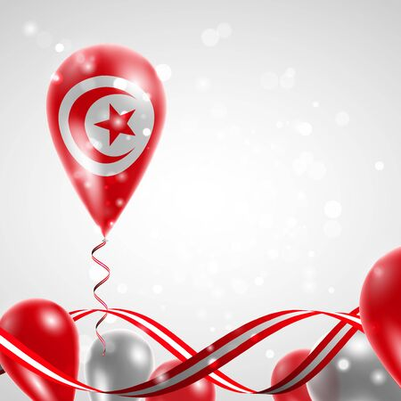 feast day: Flag of Tunisia on balloon. Celebration and gifts. Ribbon in the colors of the flag are twisted under the balloon. Independence Day. Balloons on the feast of the national day.
