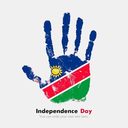 Drukken van de hand, die de vlag van Namibië draagt. Onafhankelijkheidsdag. Grunge stijl. Grungy handafdruk met de vlag. Drukken van de hand en vijf vingers. Gebruikt als een icoon, kaart, groet, drukwerk.