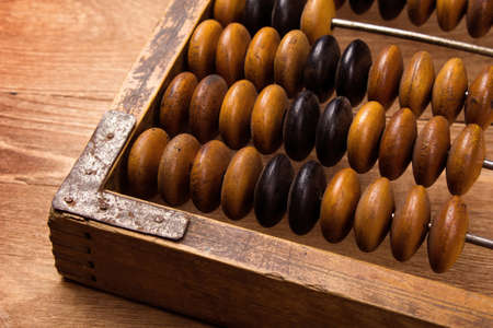 Fragment of old abacus close up