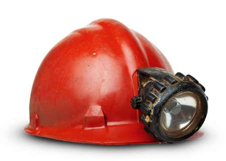 kohle: vintage Bergleute Helm mit Lampe auf einem wei�en Hintergrund
