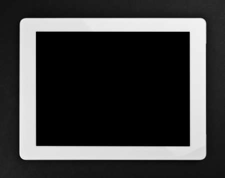 Tablet pc on black background photo