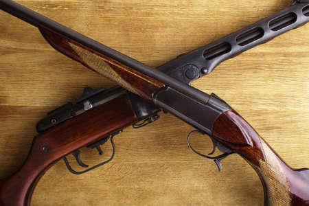 shotgun with assault rifle on wood