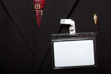 close up of blank id card on mans suit