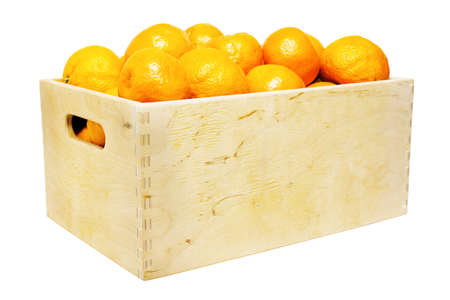 Wooden box with mandarins isolated on white photo