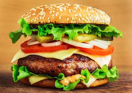 Burger on wooden table photo