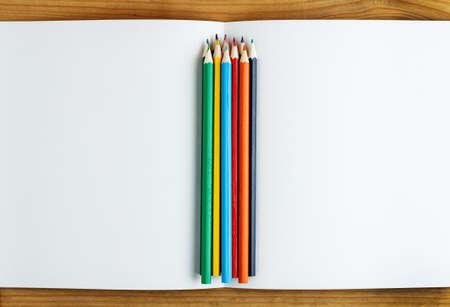 multicolored: Multicolored pencils with album closeup Stock Photo