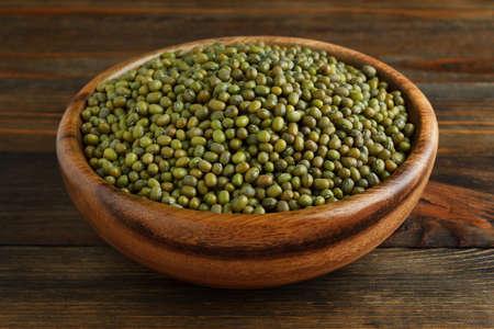 mung bean: Mung bean in a wooden bowl on wood closeup