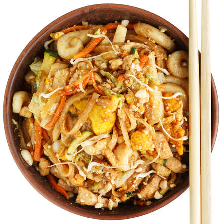Pad thai with chopsticks isolated on white