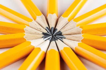 Close-up of pencils on white background arranged in circle Stock Photo