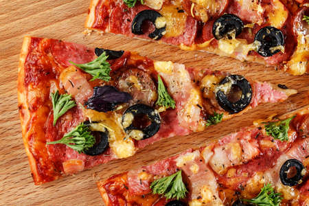 Slice of pizza on wooden board close-up