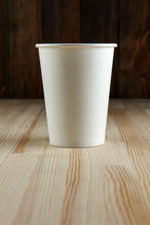 Paper cup on wood close-up Stock Photo