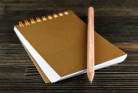 scratchpad: Notebook with pencil on wooden desk close-up Stock Photo