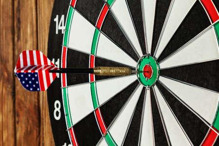 bullseye: Close-up of a dart with american flag in a bullseye Stock Photo