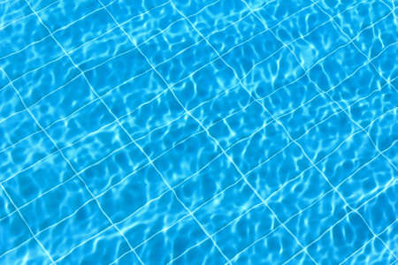 rippling: Blue rippling water in a swimming pool as a background