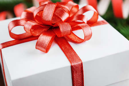 Christmas gift box with red bow close-up
