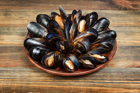bivalve: Boiled mussels in a clay dish on wood