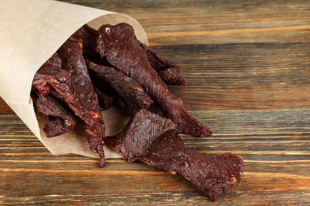 Beef jerky on a wooden board close-up Stok Fotoğraf