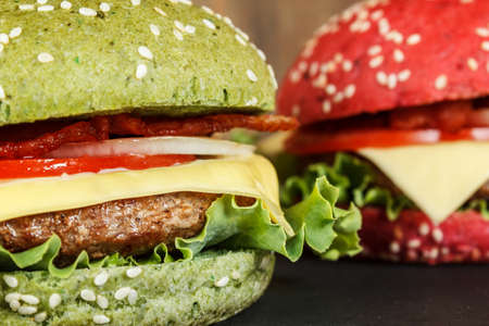cheeseburgers: Green and red cheeseburgers close-up Stock Photo