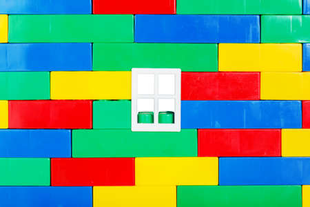 Wall with window built of multi colored toy blocks