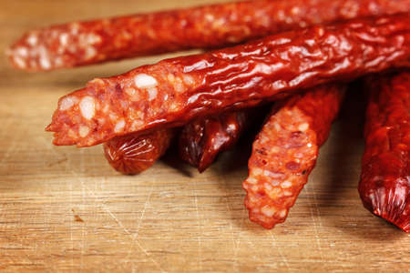 Dried sausages on wood close-up