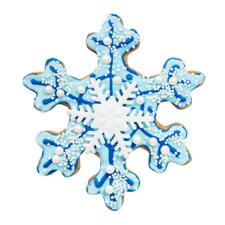 Gingerbread in a shape of a snowflake isolated on white Stock Photo
