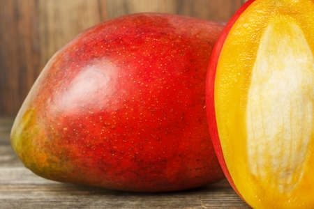 Close-up of mango on wood background Stock Photo