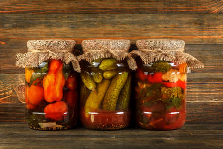 Pickled vegetables on wood background