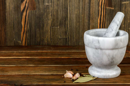 Mortar with pestle on wood background Stok Fotoğraf