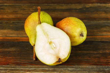 Pears on wooden table close-up