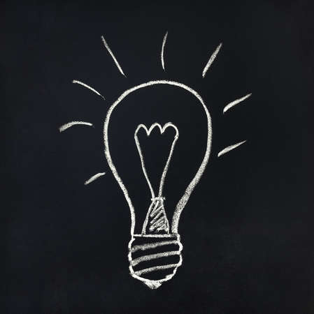 Light bulb drawn with chalk on a blackboard Stok Fotoğraf