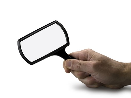 hand with magnifying glass isolated photo