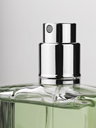 bottle spray perfume against gray background Standard-Bild