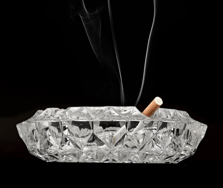 butt cigarette , ashtray  on black background Stock Photo