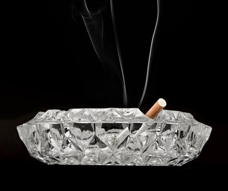 butt cigarette , ashtray  on black background Stock Photo