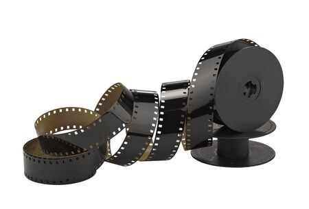 cine: old 8mm cine film and reel; isolated on white (clippin path) Stock Photo