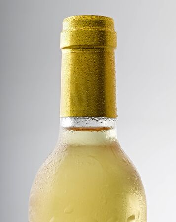 closed corks: water drop on a white wine bottle