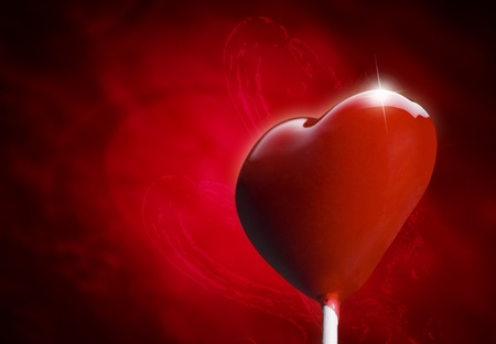 Heart-shaped lollipop hit by an arrow for the Valentines day photo