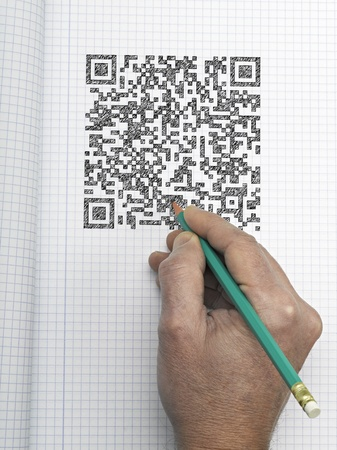 hand drawn QR CODE on graph paper Stock Photo