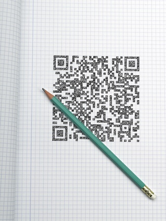Pen and QR CODE on graph paper photo