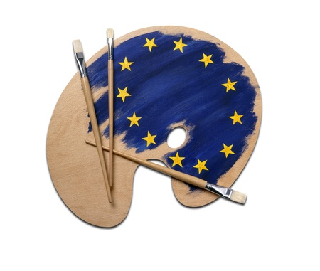 wooden artists palette loaded with european flag paints and brush, isolated on a white background with clipping path. Stock Photo - 12414088