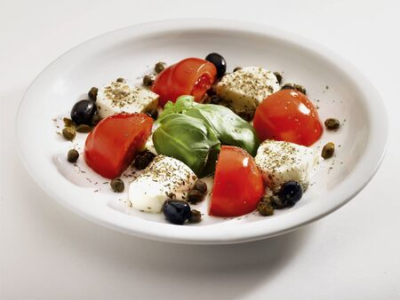plate of tomatoes and mozzarella photo