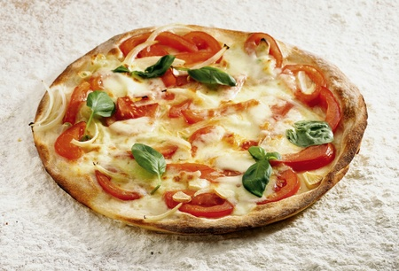 Pizza casarecce on a flour background