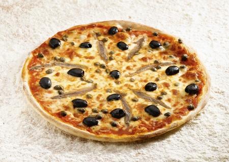 neapolitan: Pizza napoli on a flour background Stock Photo
