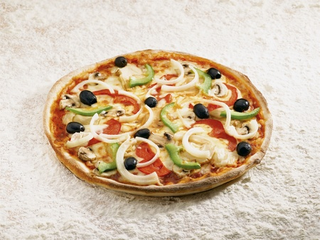 Pizza vegetale on a flour background
