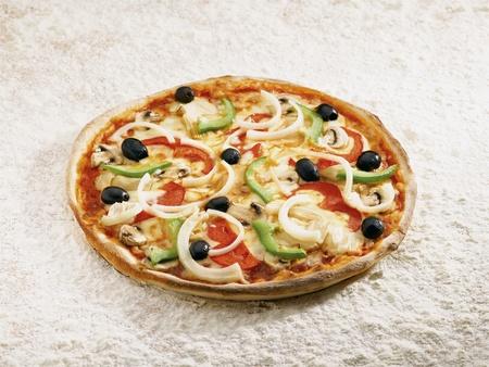 Pizza vegetale on a flour background