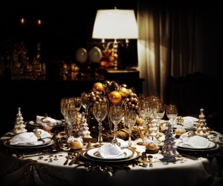 candle light: A decorated christmas dining table  Editorial