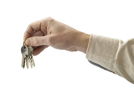 Human hand and key isolated on white background (clipping path) photo