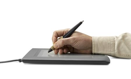 hand on graphic tablet.. Isolated on white (clipping path) Stock Photo - 12506754